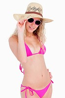 Young attractive blonde teenager posing in front of the camera in beachwear