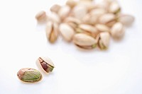 two pistachios in front of bunch of pistachios