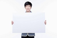 a male student with school uniform holding a big empty white paper