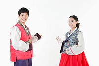 a couple introducing ways wearing Hanbok