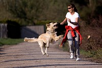 woman jog with her dog