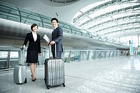 a businessman and woman smiling at camera in Incheon airport