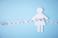 measurement tape surrounding a woman shape made out of sugar
