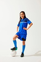 Girl Posing In Soccer Uniform With Ball