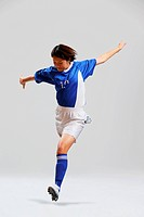 Woman In Soccer Uniform Ready To Kick a Ball