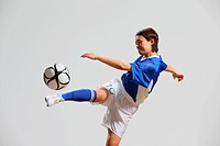 Woman In Soccer Uniform Practicing With Ball