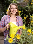 Brown_haired woman in garden, portrait