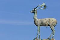 an elegant stag on a plinth, guarding the entrance to Maldraki harbour, Rhodes town Rodos