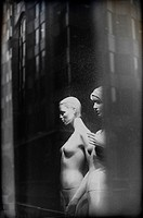 naked female mannequins in a shop window in London, England, UK