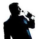 silhouette man drunk pouring empty alcohol botlle