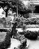 The general and meteorologist Italian Edmondo Bernacca posing with a book in his hand in the garden. Rome, the seventies