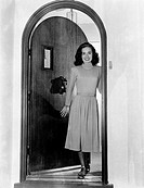 American actress and singer Ann Blyth smiling in the doorway. 1950s.