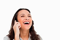 Brunette laughing while making a call