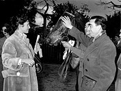 Italian actress Silvana Pampanini congratulating Mr Doumien, trainer of the horse that has won the Gran Premio delle siepi. Rome, February 1954.