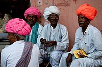 A group of men sit chatting on the street, Pushkar, Rajasthan, India