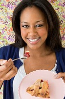 African American woman eating dessert