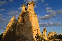 Fairy chimneys and shadows in golden light at sunset in Pasabag Monks Valley Cappadocia Turkey