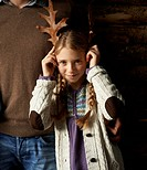 Girl using leaves as antlers