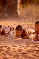 Trditional bushmen boys playing in Namiba