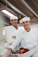 Chefs smiling in restaurant kitchen