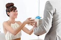 Man giving smiling girlfriend present
