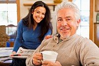 Hispanic couple smiling in living room