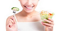 close up of Young Girl Smile eating salad