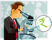 Businessman examining rupee symbol through a microscope