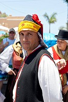 Groups of dancers and musicians celebrate Dia de Canarias, Canarian national day, dressed in colourful traditional costumes in the Plaza de Llano in A...