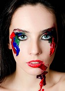 Beautiful woman with a paint on face