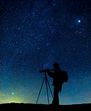 Silhouette of photographer with starry skies, Iceland digital composite Steinsholtsjokull Glacier part of Eyjafjallajokull Ice Cap, Iceland