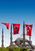 Mosque behind turkish flags