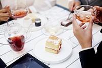 Businesswomen enjoying tea and cake at a cafe