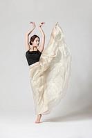 Asian young woman dancing
