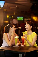 Women chatting while drinking