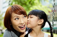 Daughter giving her mother a kiss