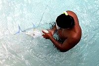 French Polynesia, Society islands, Bora Bora, fisherman
