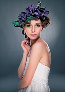 Sensual fashion model pretty girl in wreath of flowers looking
