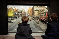 kids overlooking 10th avenue at the high line park seating area 17th street New York City