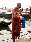 Morning prayers and meditation on the ghats of river Ganges  Varanasi, Uttar Pradesh, India