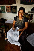 Sri Lanka - Matale, woman preparing the image pattern of batik, popular art souvenir from Sri Lanka