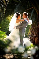 happy couple in an embrace in a private moment after their garden wedding ceremony