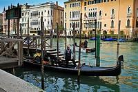 Posing Gondolier view Palazzo Sagredo, grand Canal Venice Italy