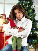 girl holding christmas puppet