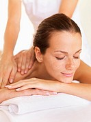 Woman relaxing while getting massage