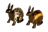 Brass and white metal design fitting on antique wooden rabbits ; Jodhpur ; Rajasthan ; India