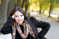 smiling young woman in autumn park