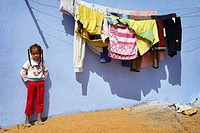 Egypt - Nubian village near Aswan, Nubian child standing before her house, South Egypt