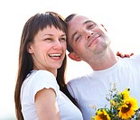 Happy young couple with flowers
