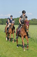 Three riders wearing a riding helmet and a body protector during a ride out